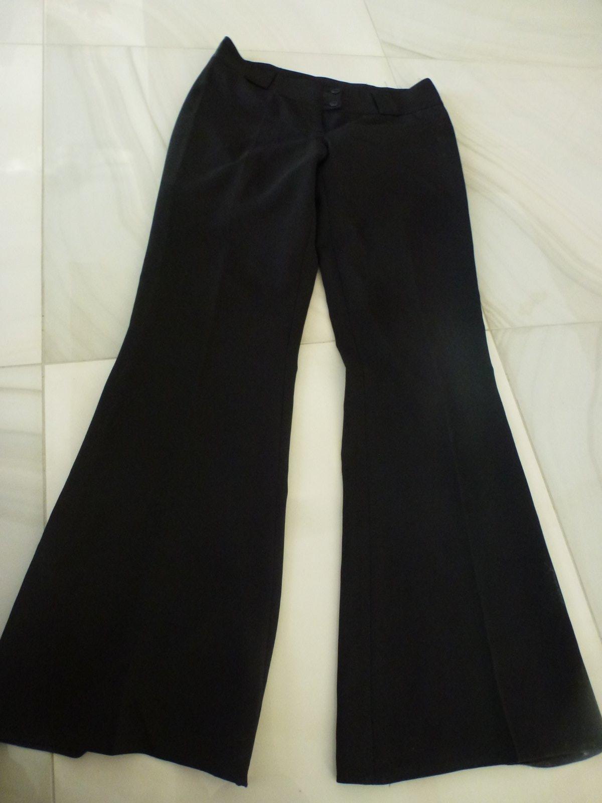 72098ed0c5e8 Čierne elegantné nohavice s pukmi