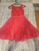 Spoločenské šaty ružovej farby,