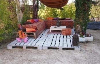 http://palletfurniturediy.com/pallet-garden/pallet-patio-deck-unique/